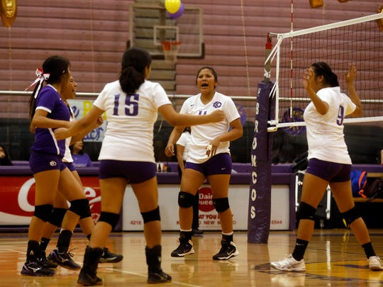 Kirtland Central celebrates after scoring a point against Bloomfield on Thursday at Bronco Arena in Kirtland.