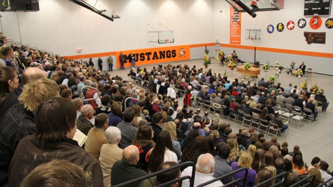 Hundreds of people crowded into the gym of Garfield County High School on Monday for the funeral of area rancher Owen Murnion.