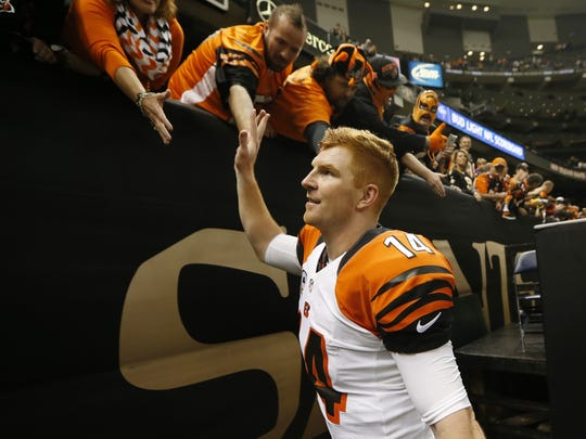 The Cincinnati Bengals quarterback Andy Dalton (14) celebrates their 27-10 win against the New Orleans Saints at the Superdome in New Orleans.