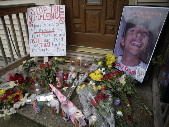 Memorial candles, flowers and other tributes to Ricardo