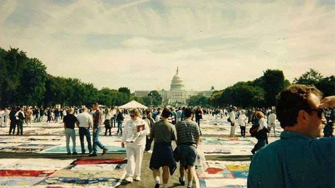 People walk among the Names Project AIDS Memorial Quilt in Washington, D.C.
