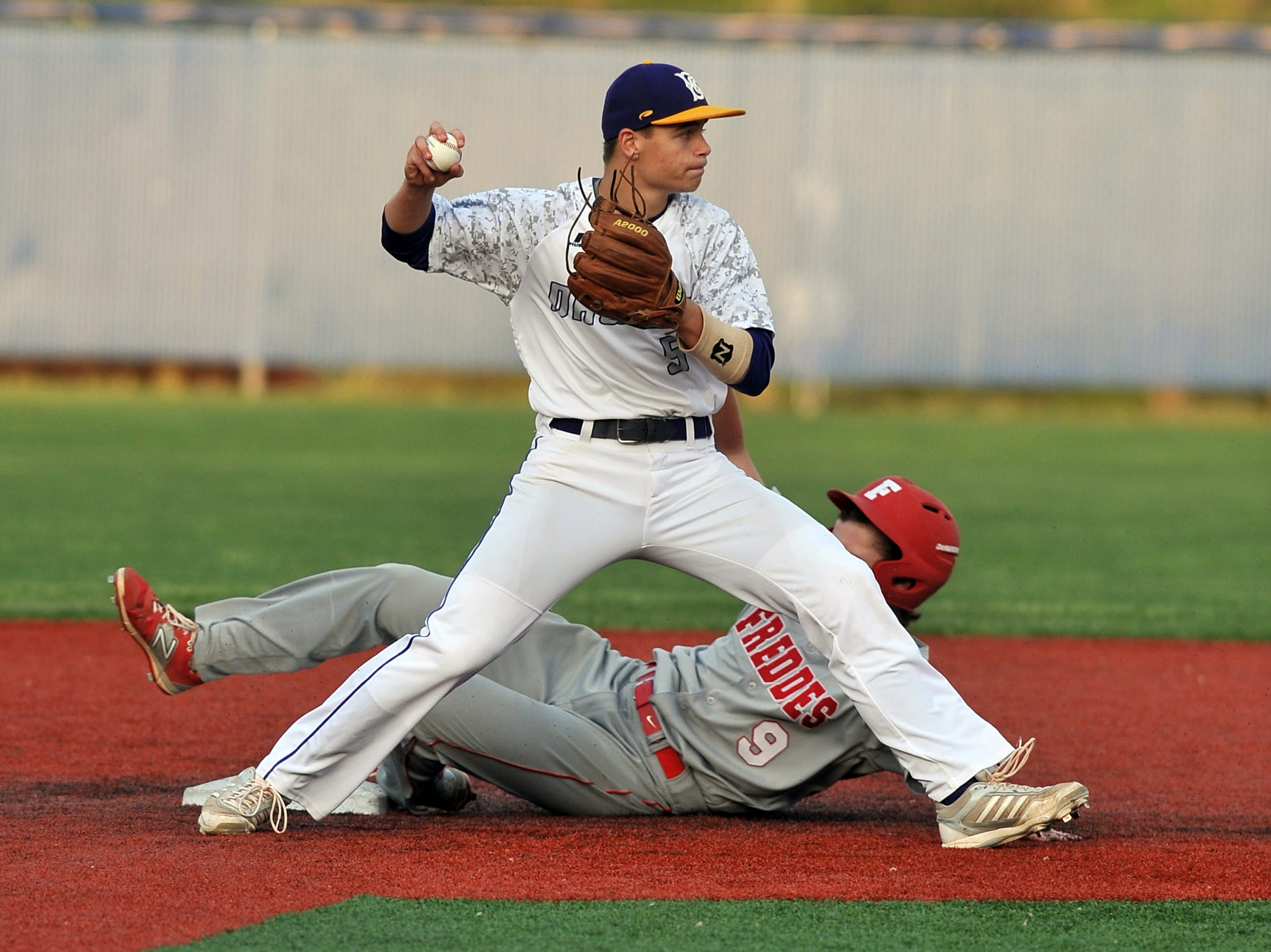 Bloom-Carroll second baseman Jack Shepherd looks to first base after recording a force out at second base against Fredricktown at Beavers Field in Lancaster. The Bulldogs won Tuesday's game 8-2.