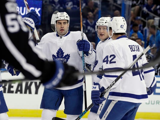 Toronto Maple Leafs defenseman Roman Polak, second from left, celebrates his goal against the Tampa Bay Lightning with teammates, including center Tyler Bozak (42), during the first period of an NHL hockey game Thursday, March 16, 2017, in Tampa, Fla. (AP Photo/Chris O'Meara)