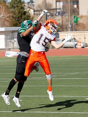 Artesia's pass attempt to wide receiver AJ Estrada, No. 15 in white, is broken up during the first quarter of Saturday's 5A state semifinal game at Hutchison Stadium.