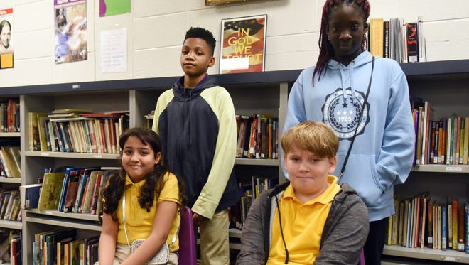 Rubba Akwieri, bottom left, Marquise Winters, top left, Excel Eneh, top right and Peyton Kavanagh, bottom right, are in the sixth grade at The S.T.E.A.M. Academy.