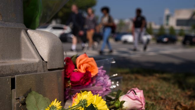 Flowers left as a memorial to IUPUI student Fatima Hassuneh, 18, who died on Monday, after being struck by a bus on the downtown Indianapolis campus, Wednesday, Sept. 20, 2017.