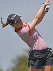 Megan Donahue tees off at the Womens' City Golf Tournament
