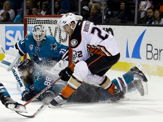 San Jose Sharks' Brent Burns (88) gets in front of a shot from Anaheim Ducks' Shawn Horcoff (22) during the second period of an NHL hockey game Saturday, Nov. 7, 2015, in San Jose, Calif. (AP Photo/Marcio Jose Sanchez)