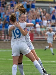 Brookfield Central midfielder Jenny Cape (19) hugs Emma Staszkiewicz after scoring the first goal of the WIAA Division 2 girls title game in the 48th minute against Oregon on Saturday.