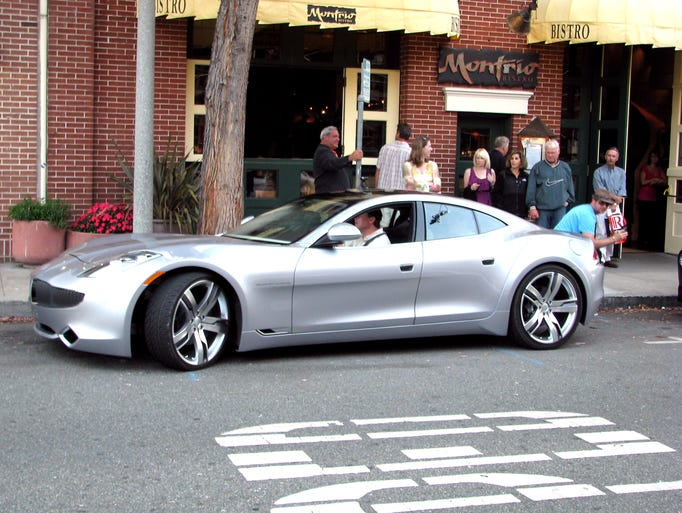The Fisker Karma, a plug-in hybrid car, took to the streets of Monterey, Calif., earlier this month in an attempt to build interest in the car. The Karma, built by Fisker Automotive of Irvine, Calif., seats four and has an electric-only driving range of 50 miles. After that, a gasoline engine kicks in. Depending on how far motorists drive daily, the car could easily top 100 miles per gallon, Fisker says. The company says it has taken orders for 1,400 Karmas so far. The starting price is $87,900 and deliveries to customers are expected to begin late next year.(Via MerlinFTP Drop)