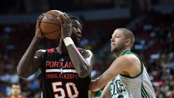 Portland Trail Blazers forward Caleb Swanigan (50) controls the ball against Boston Celtics forward Scott Wood during the second half at Thomas & Mack Arena.