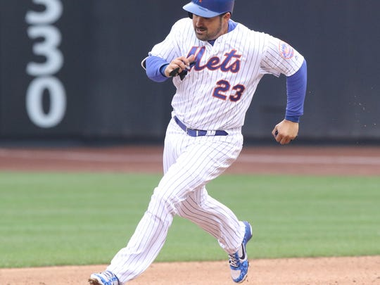 Adrian Gonzalez rounds second and scores a run for the Mets in the fifth inning.