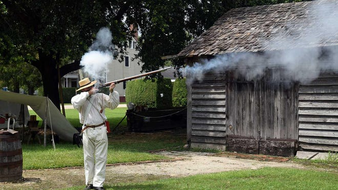 Gary Riggs does a Revolutionary War musket firing during demonstration of 'A Soldier's Life' at Tryon Palace.