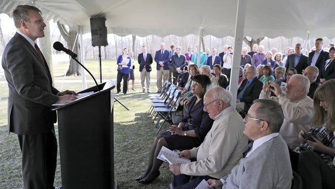 Curt Detjen, president of the Community Foundation for the Fox Valley Region, announces an estate gift of more than $100 million from David and Rita Nelson on Tuesday morning outside the Charles A. Grignon Mansion in Kaukauna.