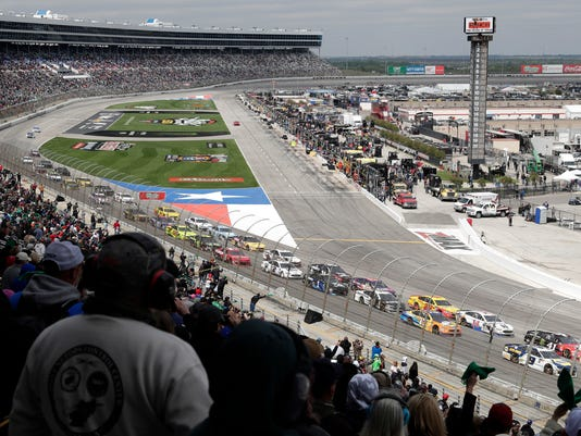Drivers head into Turn 1 after a restart during a NASCAR Cup Series auto race in Fort Worth, Texas, Sunday, April 8, 2018. (AP Photo/Tony Gutierrez)