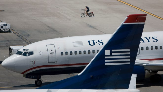A US Airways plane taxis to a gate at Sky Harbor Airport July 22, 2008.