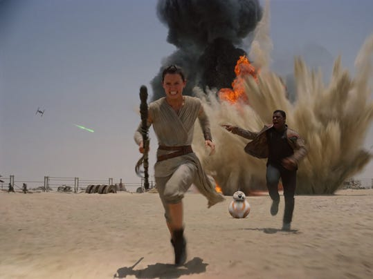 """Daisy Ridley and John Boyega in """"Star Wars: Episode VII - The Force Awakens."""" (Lucasfilm)"""