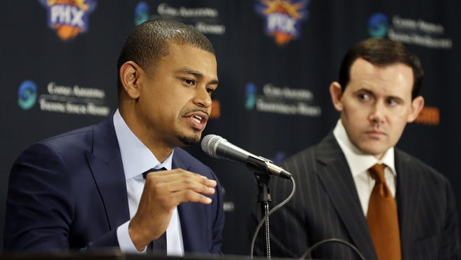 Earl Watson is introduced as the Phoenix Suns new head coach by Suns General Manager Ryan McDonough (right) during a press conference at Talking Stick Resort Arena in Phoenix, Ariz., on Tuesday, April 19, 2016.