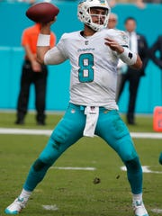Miami Dolphins quarterback Matt Moore (8) looks to pass the ball, during the second half of an NFL football game against the New York Jets, Sunday, Oct. 22, 2017, in Miami Gardens, Fla. (AP Photo/Wilfredo Lee)