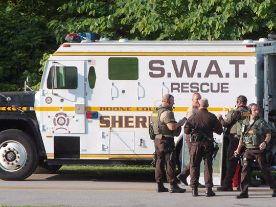 Boone County Sheriff's SWAT members gather near the entrance to Big Bone Lick State Park.