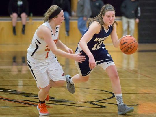 Marysville senior Devan Valko gets past Marine City junior Antonia Potvin during a basketball game Tuesday, Feb. 2, 2016 at Marine City High School.