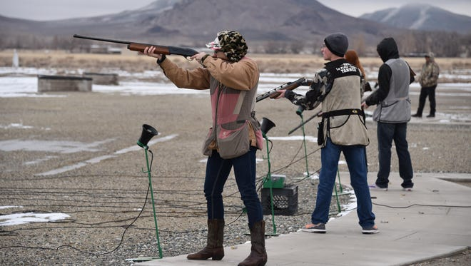 Cassie Spear takes aim at the Western Nevada Trap Cappers Youth Shooting Program at the Mason Valley Gun Club trap range Sunday.