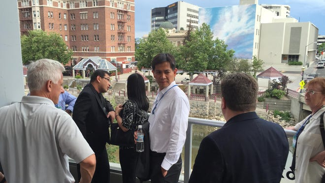 Joet Garcia, mayor of the city of Balanga in the Philippines' Bataan province, checks out downtown Reno as part of his delegation's innovation tour of the West Coast.