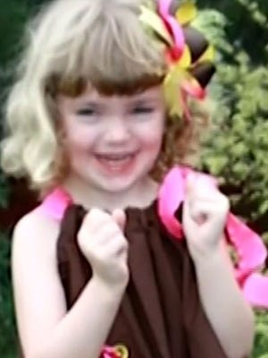 Taylor Moore, 4, died in March 2013, after she was shoved on the floor and thrown on a bed.
