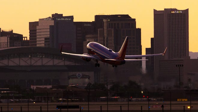 A plane takes off from Phoenix Sky Harbor Airport towards downtown Phoenix. Phoenix has argued on behalf  residents that the Federal Aviation Administration should return to a former flight path for aircraft coming and going at Sky Harbor International Airport.