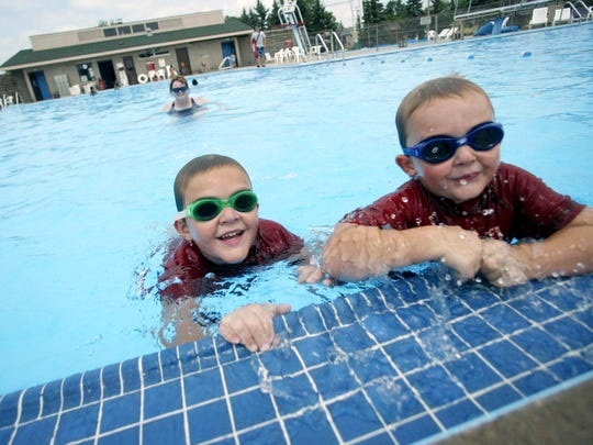 Brothers Tyler Schultz, left, and Elliott, cool off