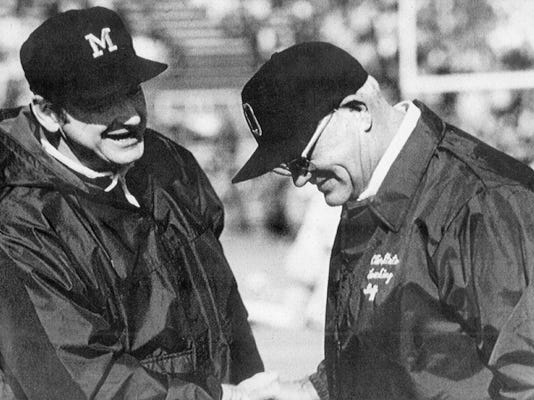 FILE - In this undated photo, Michigan football coach Bo Schembechler, left, meets with Ohio State coach Woody Hayes. No. 2 Ohio State and No. 3 Michigan have a chance to add to the lore of The Game, a football rivalry that is widely regarded as one of the best in sports, when they meet again, on Saturday, Nov. 26, 2016. (AP Photo/File)