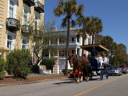 Horse-drawn carriage travels along East Battery in Charleston