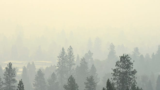 The view of west Grants Pass, Ore., Tuesday, Aug. 29, 2017, from Northwest Starlight Place. Smoke is choking the region from dozens of wildfires in the southern part of the state and will continue to do so for the foreseeable future. (Scott Stoddard /The Daily Courier via AP)
