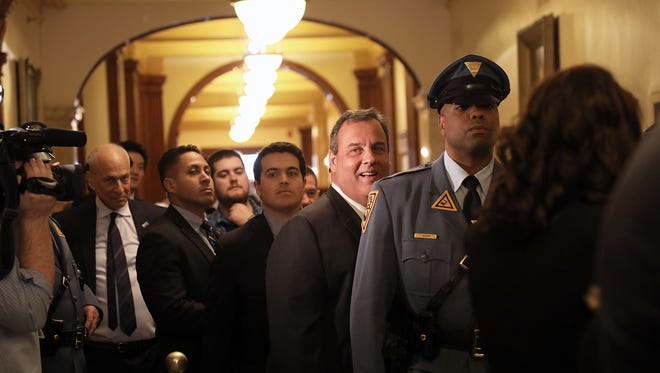 Gov. Chris Christie waits outside the Assembly room before he is introduced to deliver the State of the State address on Jan. 9, 2018.