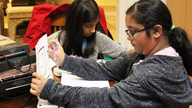Hillsborough Girl Scouts Jiya-Tushar-Purandare, left, and Krisha Patel, members of Troop 60527, attended a workshop on design at Ethan Allen Interior Designs.