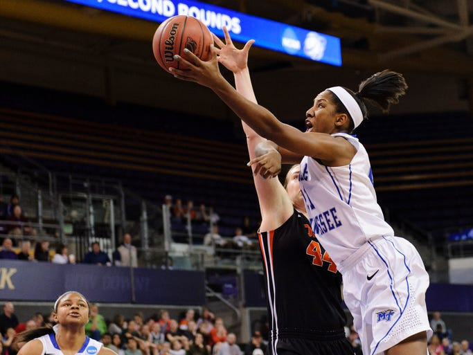 Middle Tennessee forward Ebony Rowe (21) shoots the ball in front of Oregon State center Ruth Hamblin (44) in the first half.