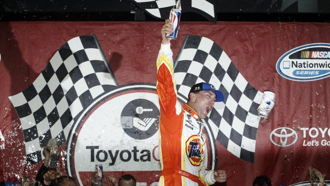 Kevin Harvick held off Chase Elliott to win the rain-delayed Nationwide race at Richmond on Friday night.
