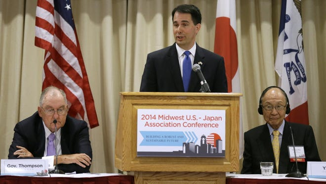 In this file photo, Wisconsin Gov. Scott Walker speaks during the annual meeting of the Midwest U.S-Japan Association, Monday, Sept. 8, 2014, in Des Moines, Iowa. The group, founded in 1967, meets yearly to discuss the growth and progress of economic relations of the American Midwest and Japan.