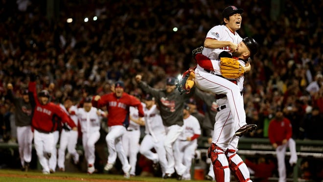 Red Sox catcher David Ross scoops up pitcher Koji Uehara during the celebration following Game 6. This year's World Series averaged 14.9 million viewers, led by 19.2 million for Wednesday's decisive Boston win.