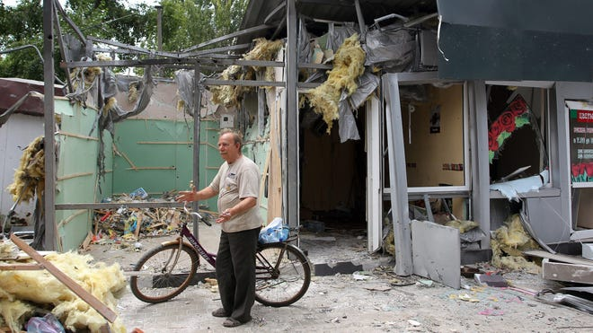 A man looks at debris and rubble on the outskirts of Donetsk, in eastern Ukraine, on July 25, 2014.
