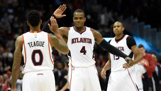 Atlanta Hawks guard Jeff Teague (0) and forward Paul Millsap (4) are part of the Hawks group that set a team record for wins last season.
