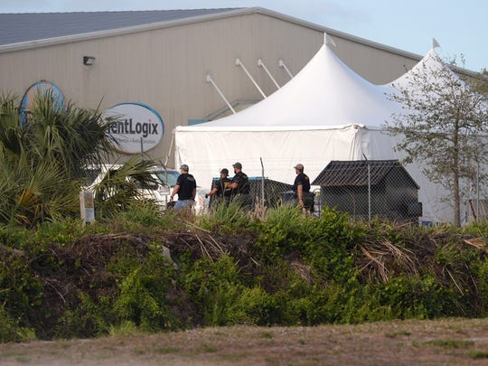 Homeland Security agents raid the TentLogix business on Wednesday, March 28, 2018 in Fort Pierce.