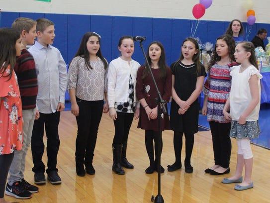 5th grade chorus students from Warren E. Sooy Jr. Elementary