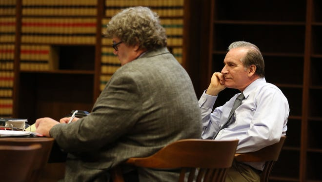 Defense attorney John Storkel, left, and defendant John Rideout listen to opening statements by Marion County Deputy District Attorney Gillian Fischer on Tuesday, March 14, 2017, at the Marion County Courthouse in Salem. Rideout was arrested in July of 2016 on two counts of first-degree rape. In 1978, Rideout was made infamous as the first man in American history to go to trial for raping his wife while they were living together; the jury in that case unanimously acquitted him.
