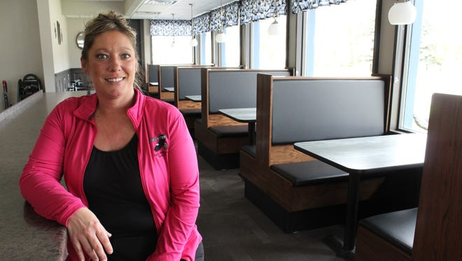 Owner Melissa Butt sits at the counter of the new Eagle's Nest at  280 Grand Ave., Schofield. Previously, the popular restaurant was located just down the road, at 2105 Grand Ave., Wausau.