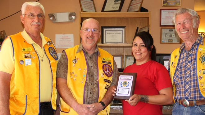 The Alamogordo Breakfast Lions Club presented an appreciation and thank you award to the Alamo Grill. The Breakfast Lions Club delivers Thanksgiving meals to housebound senior citizens on Thanksgiving Day. Alamo Grill, 20913 White Sands Blvd., prepares the Thanksgiving meals for the Breakfast Lions Club members to deliver. Pictured left to right, Club Vice-President Bob Hein, President Jeffrey Alber, Alamo Grill waitress Amanda Ortiz and Secretary Jerry Austin.