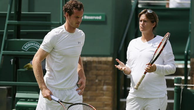 A Saturday, June 27, 2015 photo from files showing Britainís Andy Murray, left, speaking with his coach Amelie Mauresmo during practice ahead of the the All England Lawn Tennis Championships in Wimbledon, London.