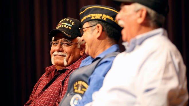 Veteran Israel Ramirez laughs as he talks with other veterans Friday, Nov. 11, 2016, at Premont High School in Premont.
