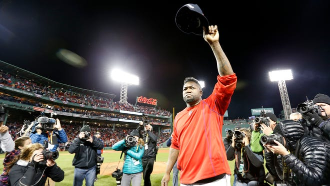 David Ortiz salutes the fans after his final game in a Red Sox uniform.