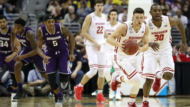 Wisconsin guard Zak Showalter dribbles up the court Saturday against Northwestern at the Verizon Center in Washington, D.C.